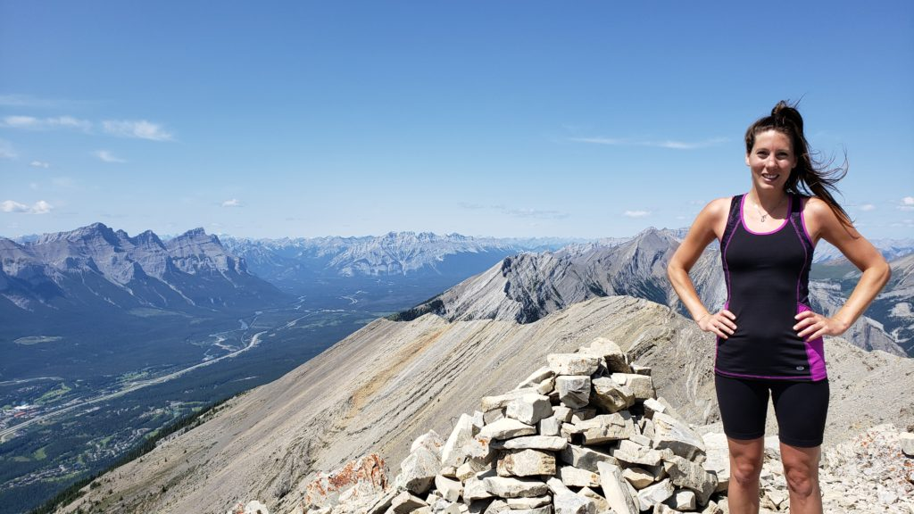 Elisha Comeau standing on Grotto Mountain Summit