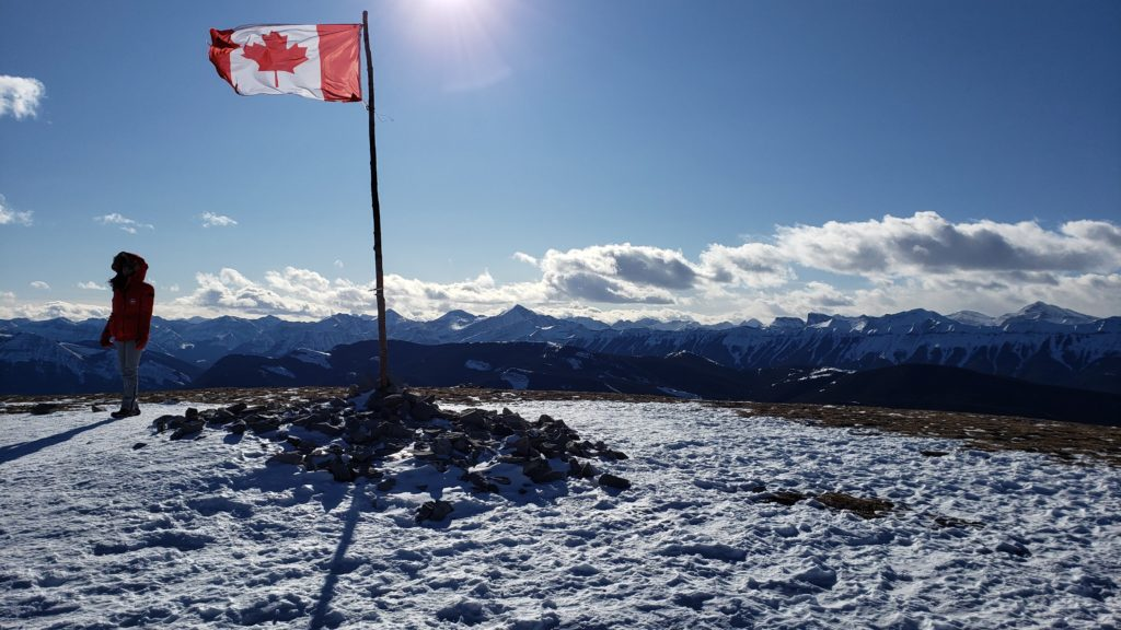 Picture of the beautiful and breathtaking Summit at Prairie Mountain. Including a Canadian Flag.